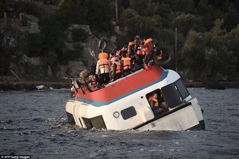 overcrowded refugee boat refugee bodies wash up on lesbos including children after