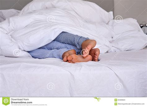 lovers in bed tangled lovers feet stock photo image 60389820