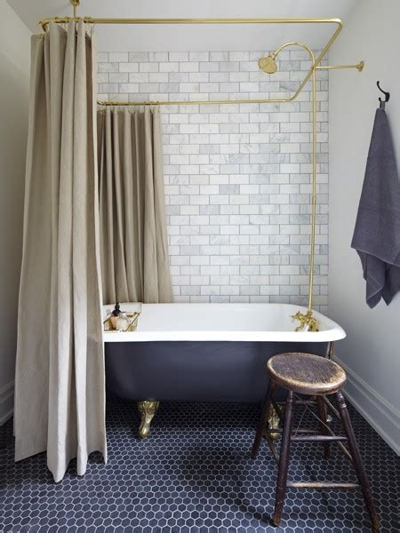 the tile work but the charcoal claw foot tub and