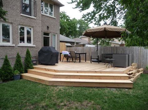 how to design a deck for the backyard what the client s backyard cedar deck looked like before