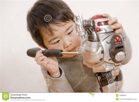 boy fixing robot stock photo image of persons tools