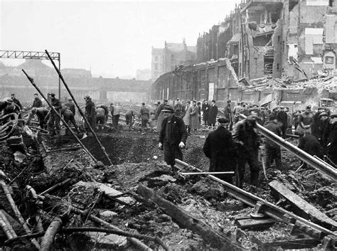 the london blitz republic of britain at war the view towards victoria station as military personnel assist railway