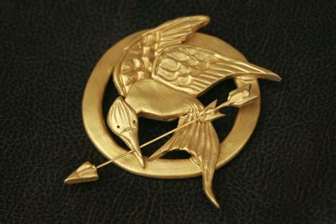 How To Make A Mockingjay Pin Out Of Paper - mockingjay pin 183 a clay brooch 183 molding on cut out keep