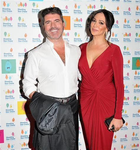 Simon Cowell and Lauren Silverman look loved up at charity