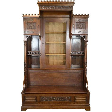 bookcase to bench gothic revival bookcase with bench and storage circa 1875