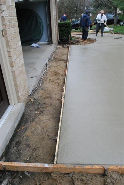 Drain In Front Of Garage Door Concrete Aggregate Driveway Dirt Simple