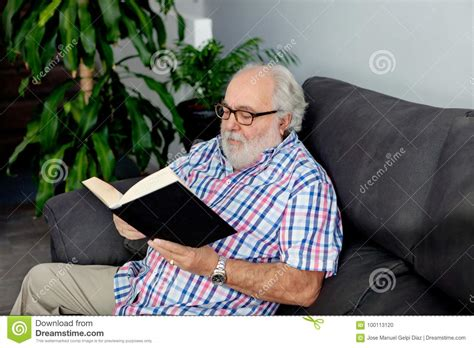 a in his home books retired reading a book in his home stock photo image