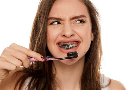 trendy charcoal toothpastes linked  tooth decay