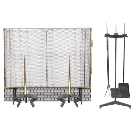 wrought iron and brass fireplace set by donald deskey for