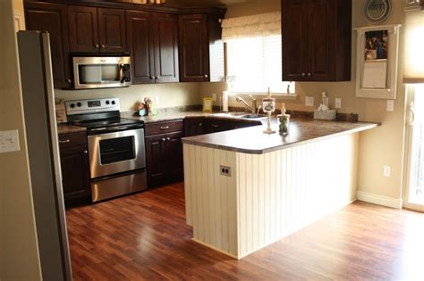 kitchen colors for dark wood cabinets what is the best way to paint kitchen cabinets home faithful