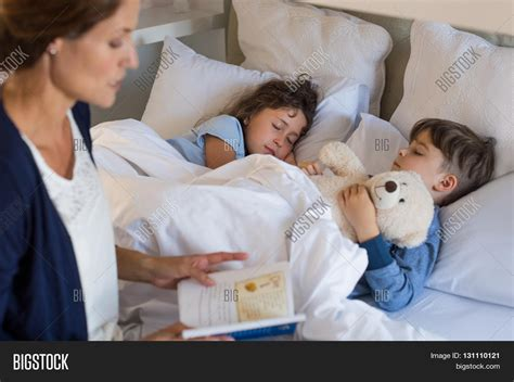 putting kids to bed mother reading bed time stories image photo bigstock