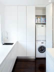 Kitchen Laundry Ideas minimalist laundry room photo in sydney with white cabinets