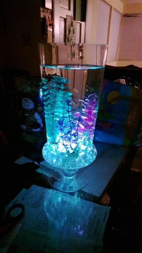 the sea centerpieces 5 to 10 dollar glass vase from walmart stones and glow sticks from dollar store and fish tank
