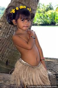 Young philippines girl dressed in a grass skirt with a yellow