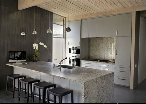 Island Peninsula Kitchen waterfall granite with one edge against the wall for a