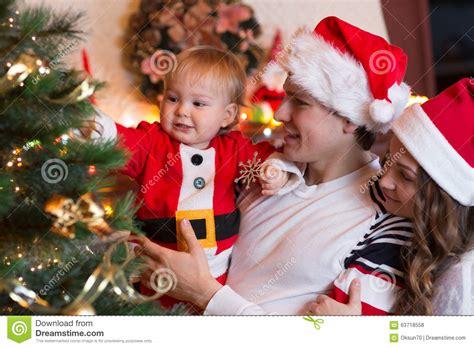 family christmas tree jarrettsville family decorating tree in living room stock photo image 63718558