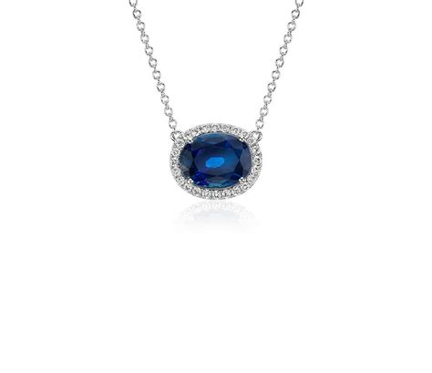 oval sapphire and halo floating pendant in 18k