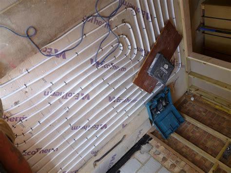 installing underfloor heating  solid floors thegreenage