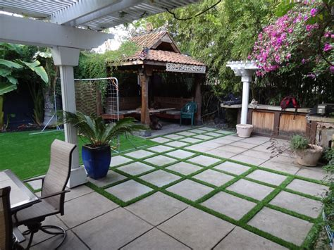 pavers in backyard artificial grass installed in the entire backyard and side