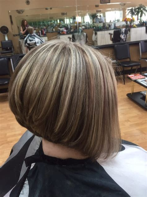 pale highlights with brown lowlights the cut
