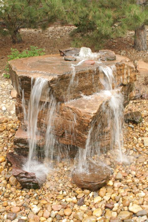 drilled sandstone water feature pondless garden