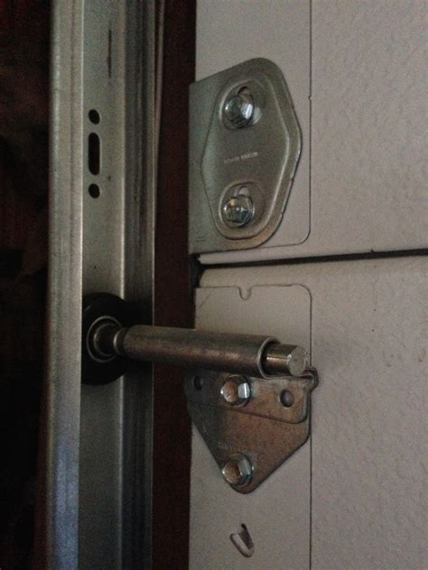 Lubricating Garage Door Rollers Garage Door Roller Lubricant How To Fix A Noisy Garage Door The Family Handyman How To Choose