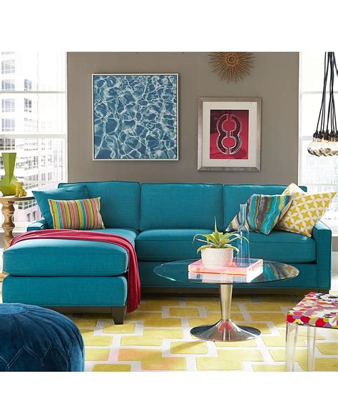 living room with blue sofa keegan fabric sectional sofa living room furniture