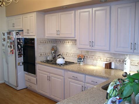 Kitchen Magic Refacers Newly Refaced White Kitchen Cabinets To Brighten Up The