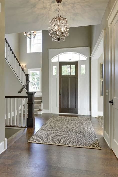 gorgeous dark walls and high ceilings with minimal but traditional statement furniture pieces gorgeous entryway with high ceilings tall front door