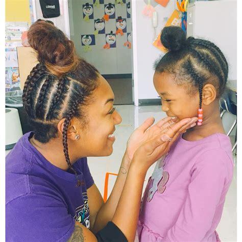 beachinf pre k hair black girl magic pre k teacher shows her student how