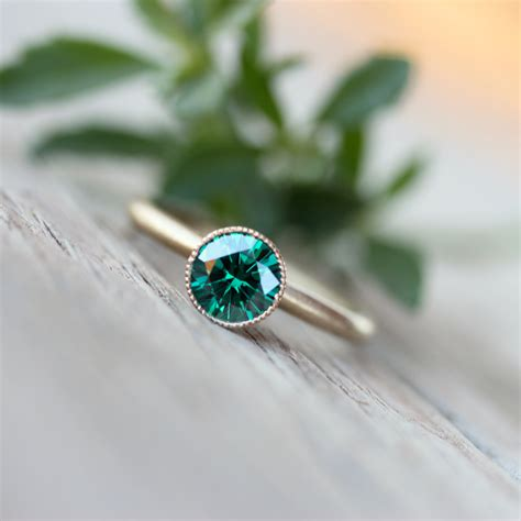 woodland engagement ring emerald green moissanite 14k yellow