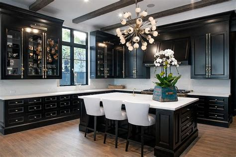 white kitchen cabinets with brass hardware and black glass front kitchen cabinets with polished brass cremone