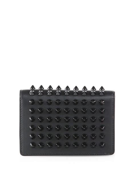 christian louboutin milos spiked leather foldover wallet in black lyst