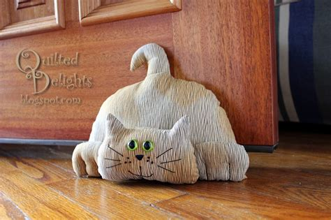 free sewing pattern cat doorstop quilted delights don t let the door stop you blog hop
