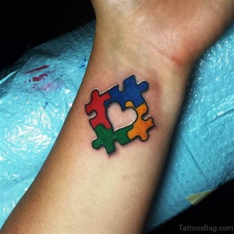small autism tattoos 40 mind blowing autism tattoos on wrist