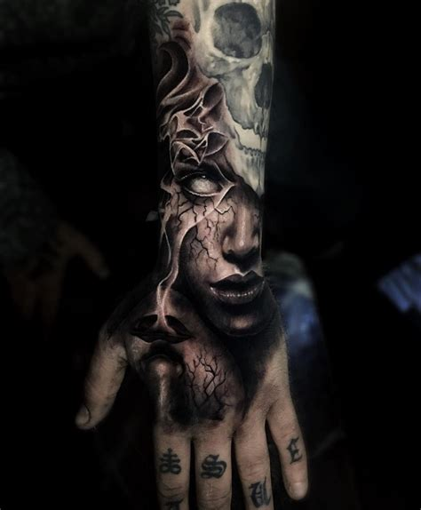 evil portrait hand piece with white eye s best tattoo