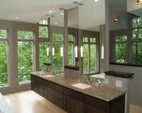 floating vanity along with e use of glass give this