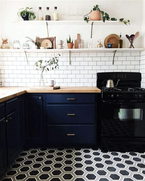 black patterned kitchen tiles compact kitchen renovation with brass drawer pulls white