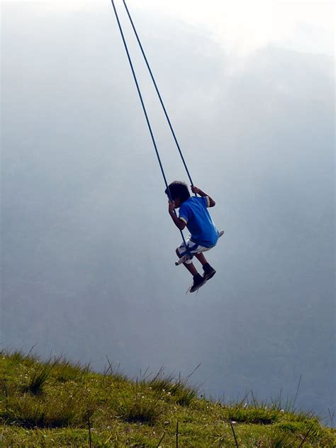 swing over riding a swing over a cliff in ecuador is bucket list