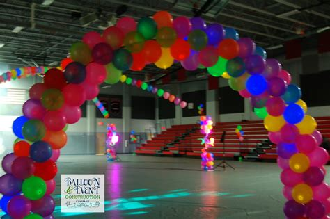 Neon balloon arches creekside high school homecoming