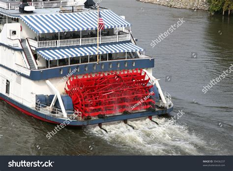 old boat paddles old fashioned paddle boat in a river stock photo 39436237