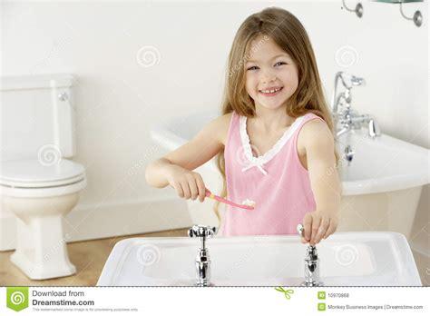 Sink Teeth brushing teeth at sink royalty free stock