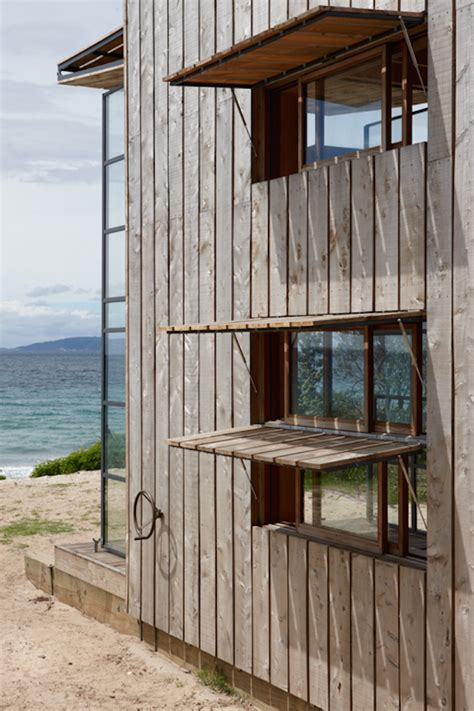 storm awnings beach house with massive windows built on skids