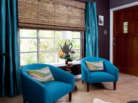 teal livingroom 2018 teal vintage club chairs and drapes in living room hgtv