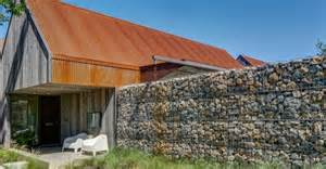 building a home gabion walls and recycled steel panels clad an outstanding