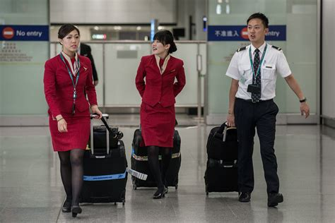 emirates flight attendants based in hong kong oppose wearing china cathay pacific agrees to end skirts only uniform rule time