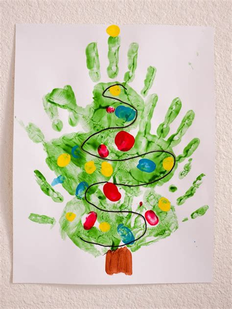 christmas tree crafts for preschool using handprint hiccups print trees