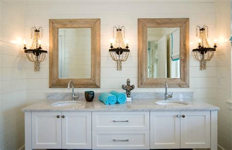 Shell Bathroom Mirror - bathroom with wood framed mirrors and shell sconce lighting at the beach with kris