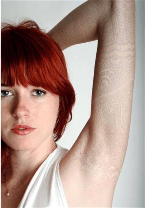 subtle tattoos a white lace on pale skin creates the subtle