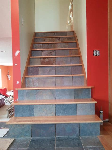 custom staircase installation slate tile installed   risers  solid hardwood installed
